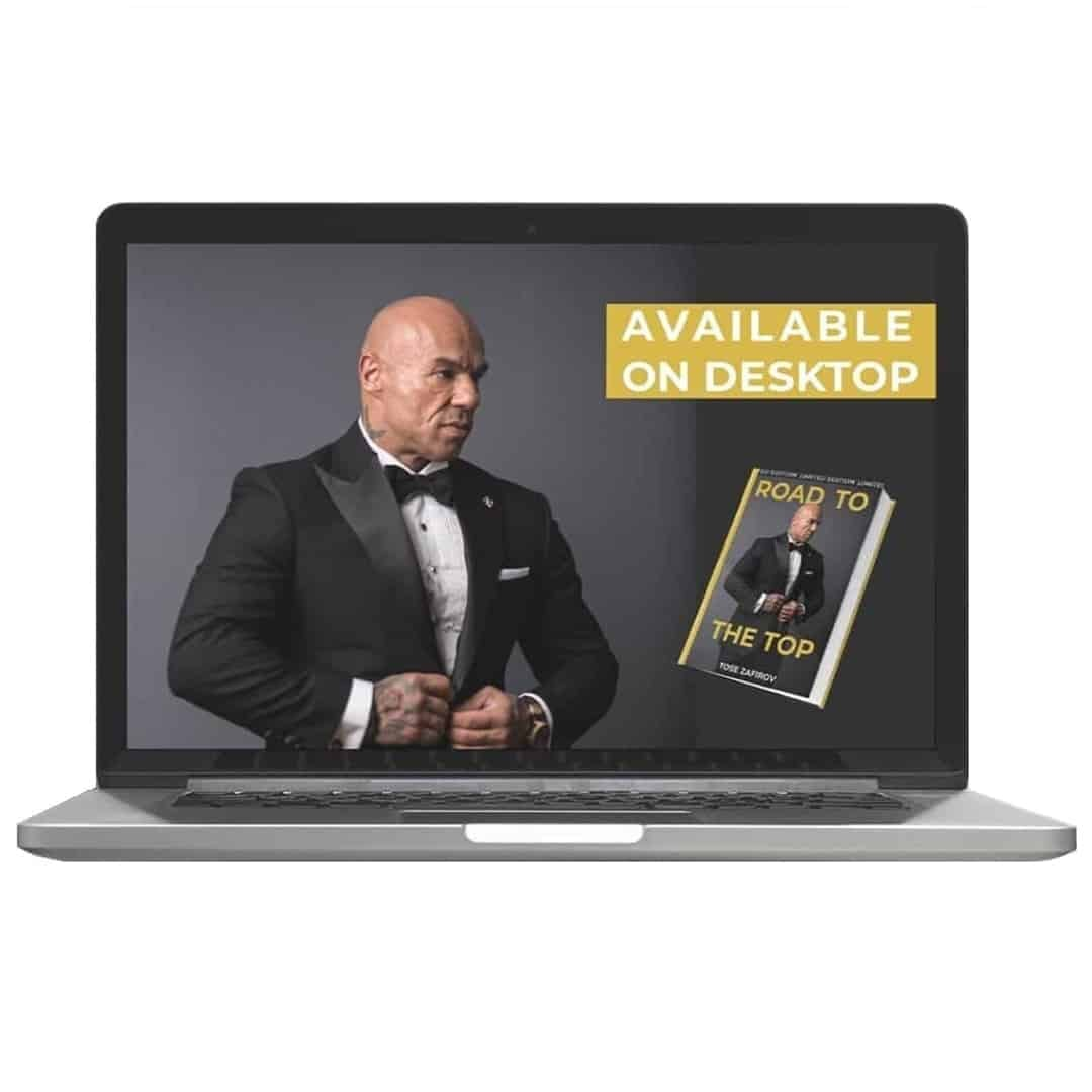 Tose Zafirov's book known as Road to the Top showcased on a laptop, where we can see Tose Zafiorv, in a black suit, posing on a grey background.