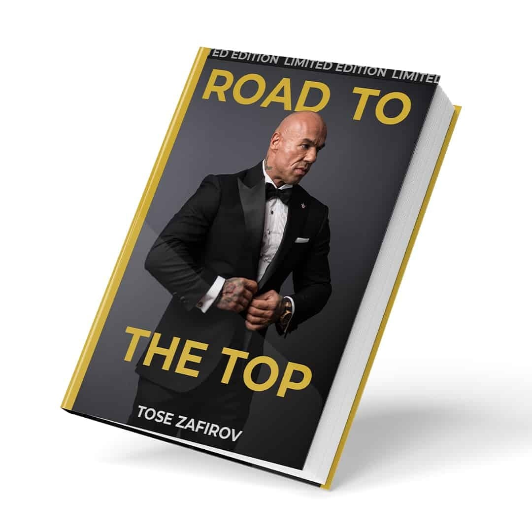 Tose Zafirov's book known as Road to the Top showcased in actual book form, where we can see Tose Zafriov in a black suit, posing on a grey background, and golden letters. This is first Book by Tose Zafirov listed in the Books Category.