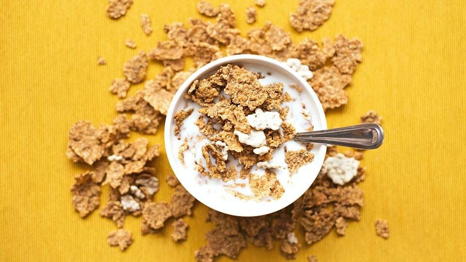 Breakfast cereal with Greek yoghurt in a cup.