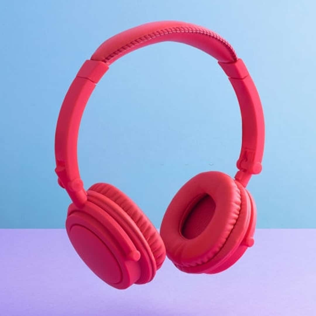An image of red headphones on a blue background.