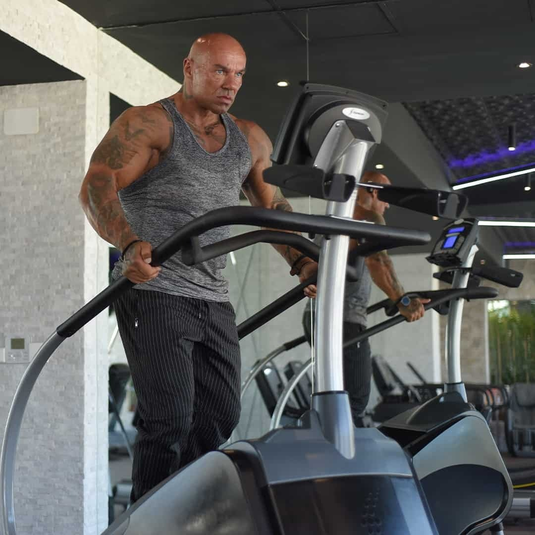Tose Zafirov in a grey t-shirt and grey sweatpants, doing cardio in the Pulse Fitness Center.