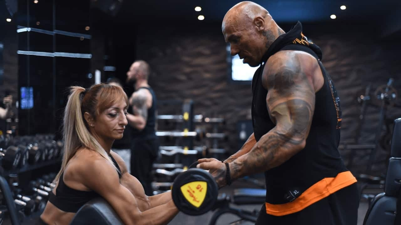 Tose Zafirov in a black t-shirt with orange details, training at the gym with Gabriela Zafirova. Photo session for Team Z campaign.