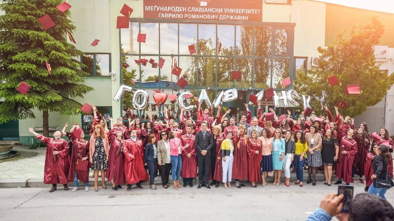 Image of students that have just graduated, together with teachers in front of the International Slavic University.
