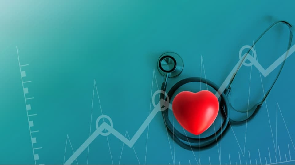 An image of stethoscope, and a red heard on a turquoise background.