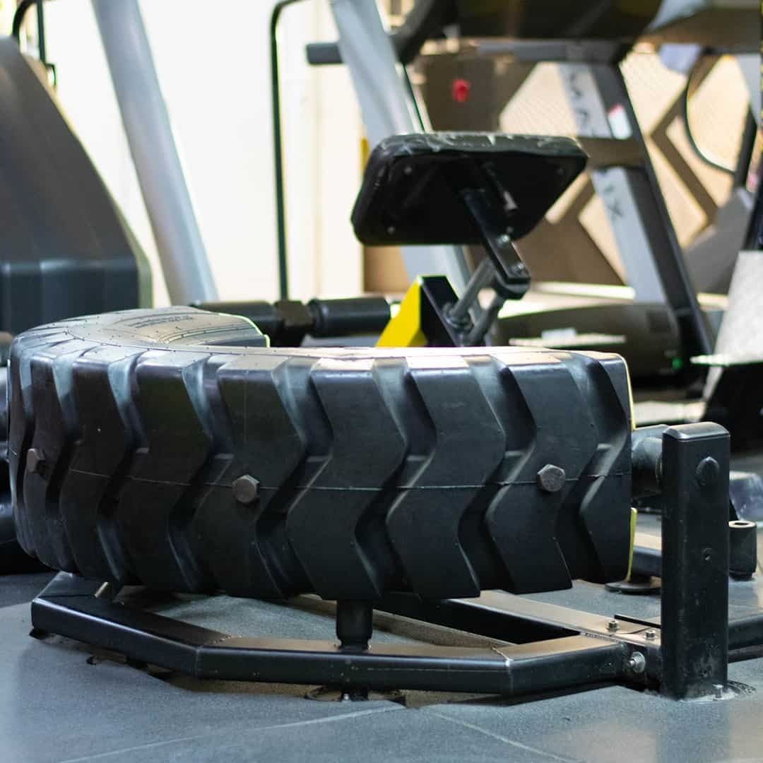 Tose Zafirov Gladiator Fitness Center showcasing a tire exercise where the person training can lift up the tire.