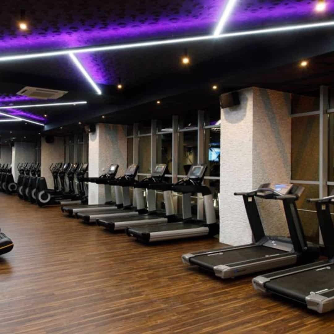 An image of the Pulse Fitness Center, with running track machines on it.