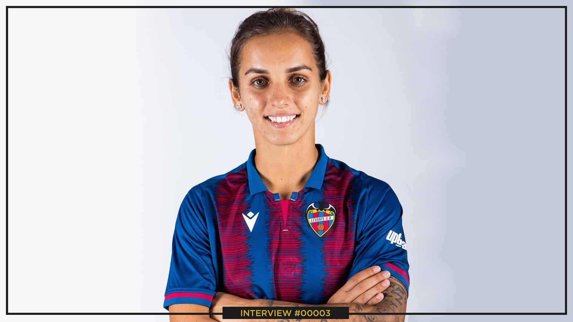 Natasa Andonova smiling with white teeth and staring straight at the camera, on a white background. She is wearing her Levante jersey.