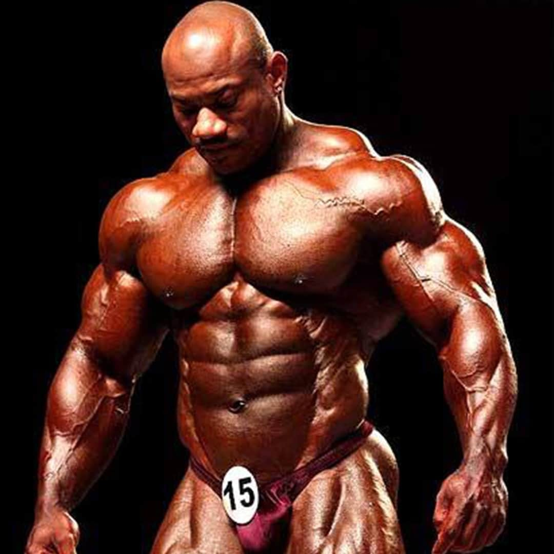 An image of Dexter Jackson. He is wearing red trunks with number 15 on it, and he is without t-shirt.