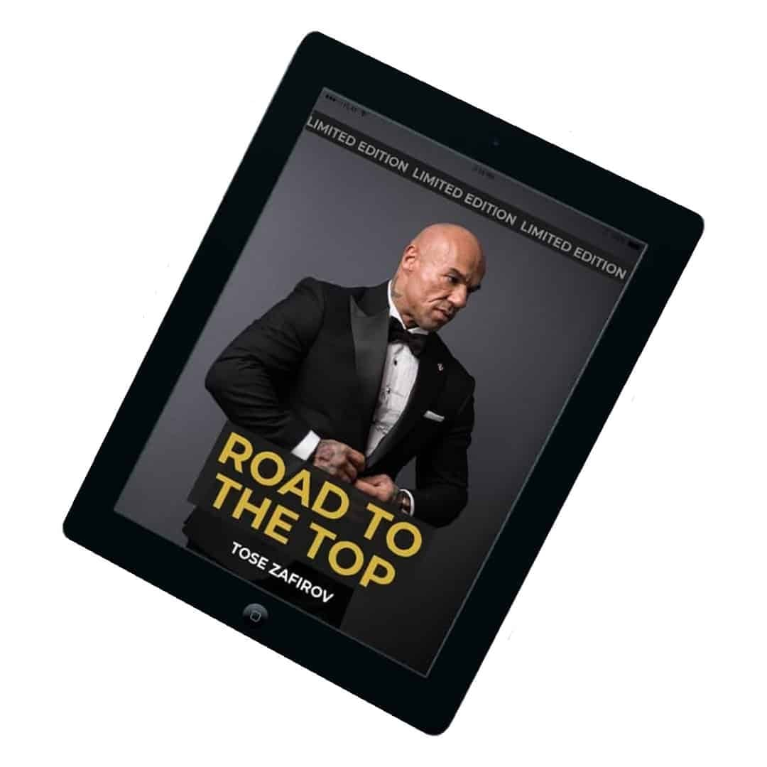 Tose Zafirov's book known as Road to the Top showcased on a tablet, where we can see Tose Zafiorv, in a black suit, posing on a grey background.