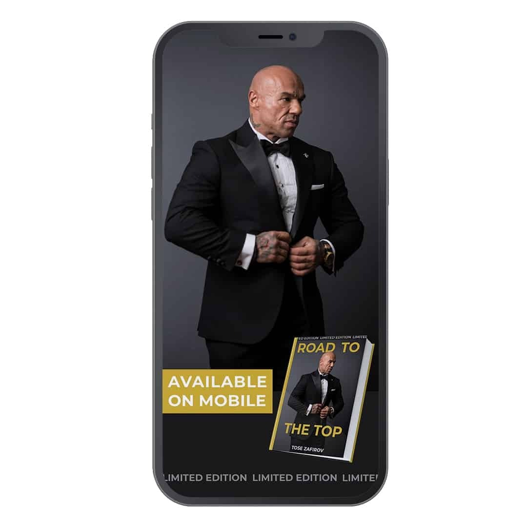 Tose Zafirov's book known as Road to the Top showcased on a phone, where we ca see Tose Zafriov in a black suit, posing on a grey background. The book topic is with gold letters.