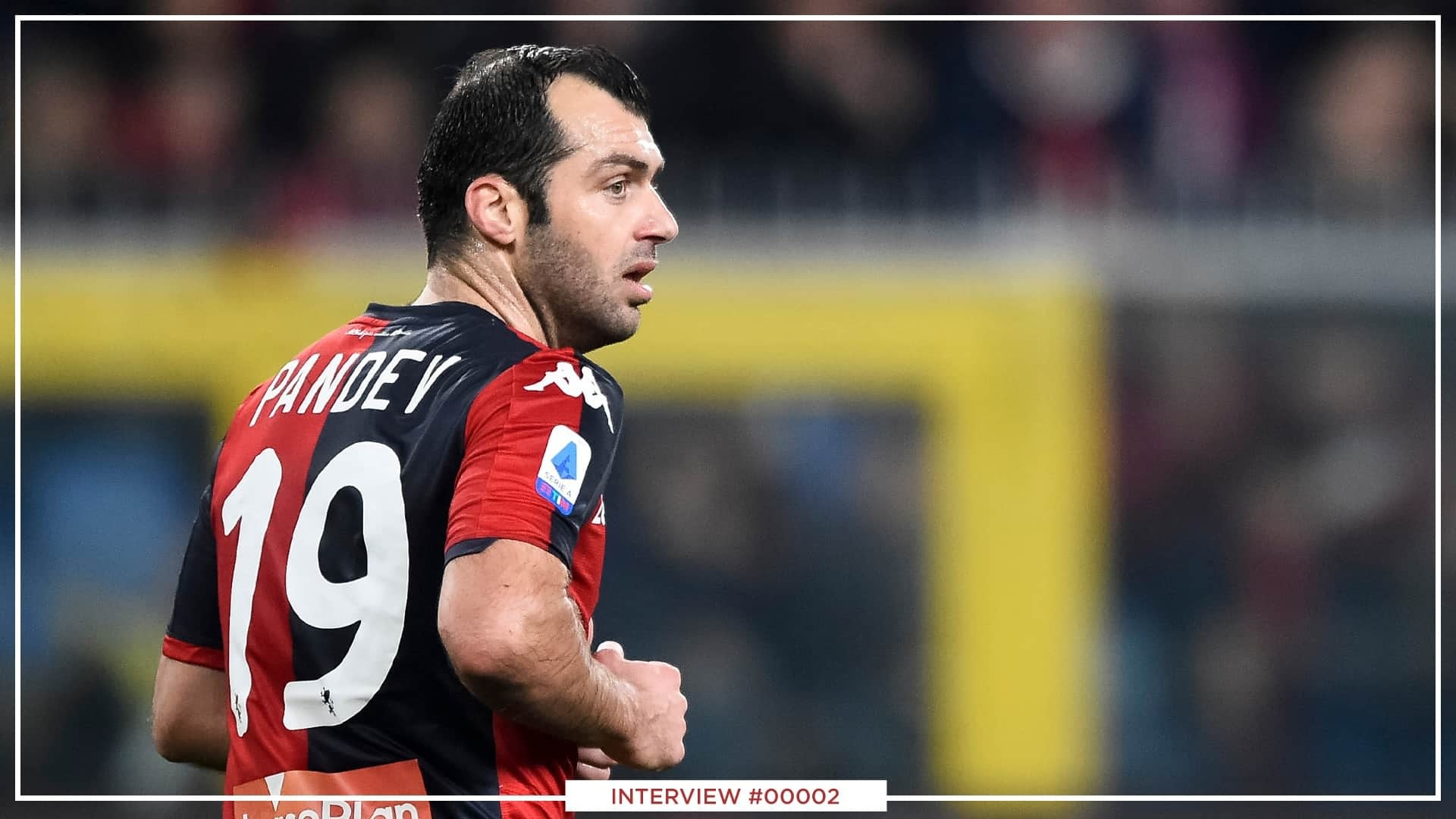 Goran Pandev while playing football. He is wearing his Milan jersey with the number 19 on the back.