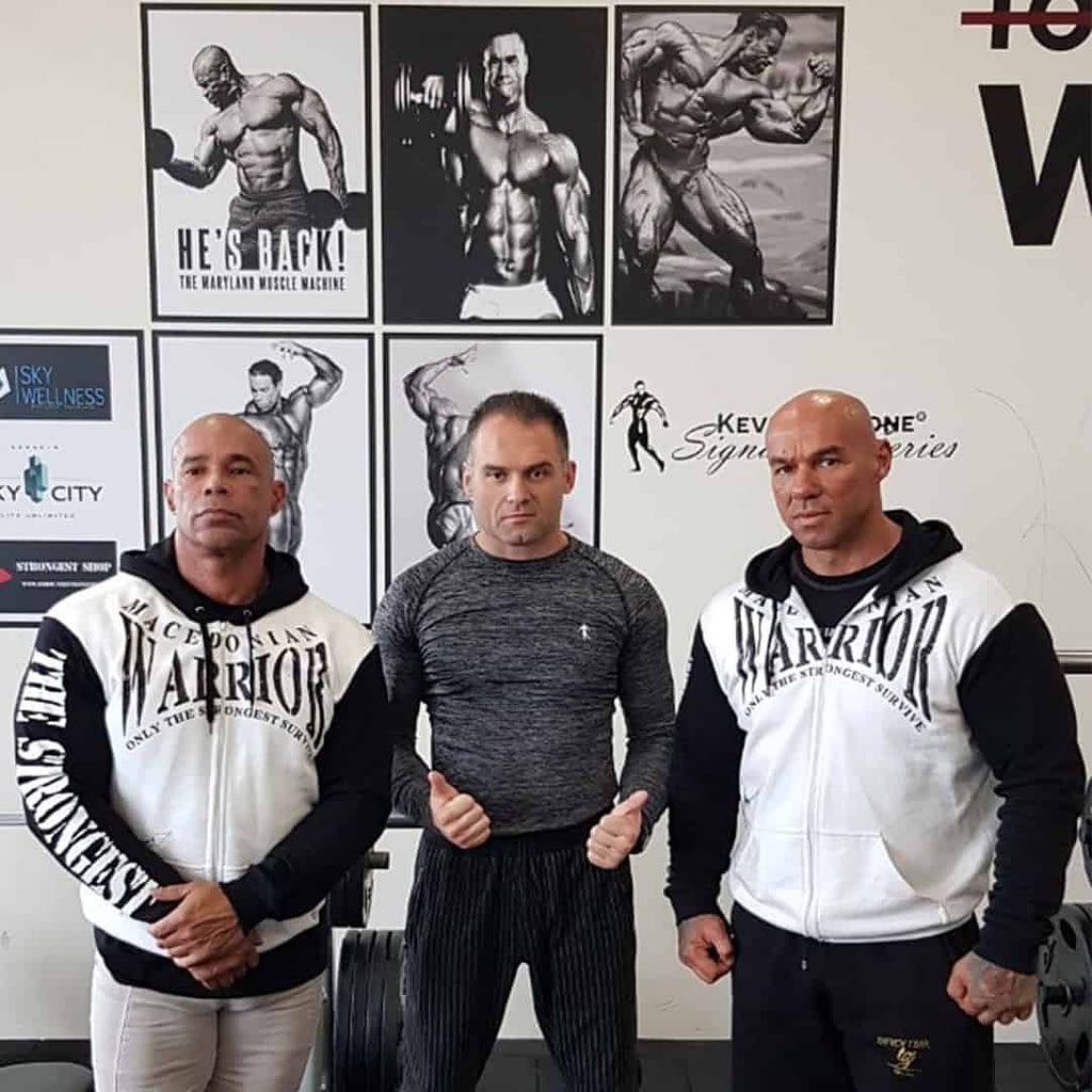 An image of Tose Zafriov, Ivica Aleksovski, and Kevin Levrone standing together. Tose and Kevin are wearing ''Macedonian Warrior'' hoodie from the Strongest, and Ivica is wearing grey Levrone blouse.