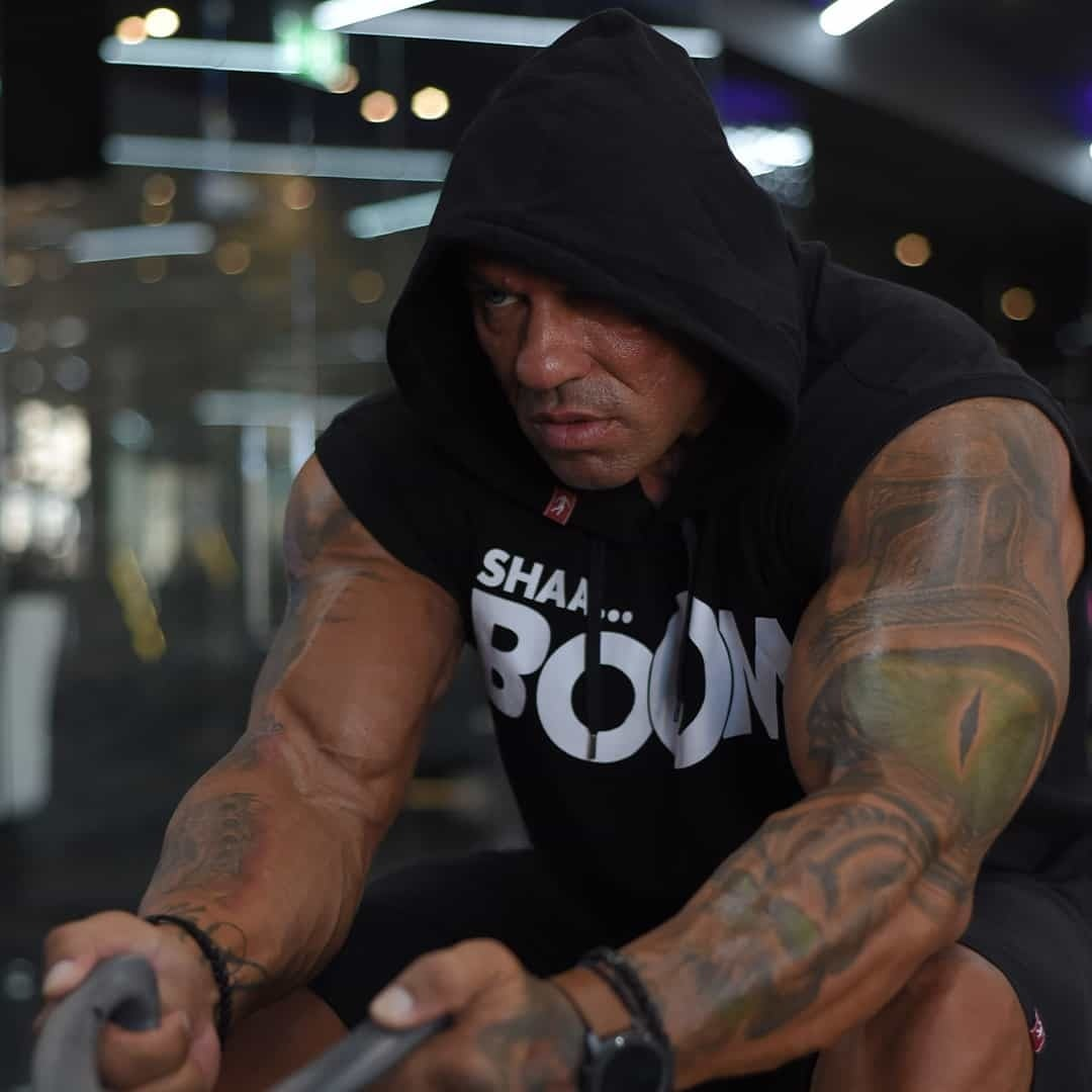 Tose Zafirov in a black t-shirt with hood on his head and white ''BOOM'' sign on it, training at the Pulse Fitness Center.