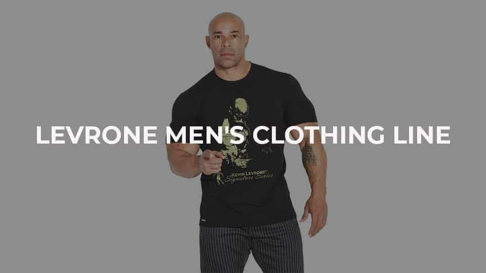 Kevin Levrone posing in clothes from his collection on a white background, ''Levrone Men's Clothing Line'' is in the focus of the photo.