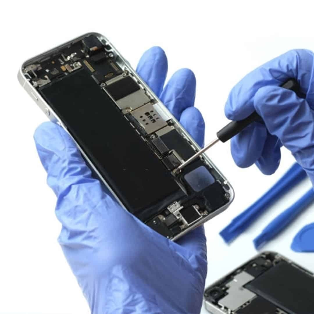 An image of hands with blue medical gloves, repairing a phone on a white background.