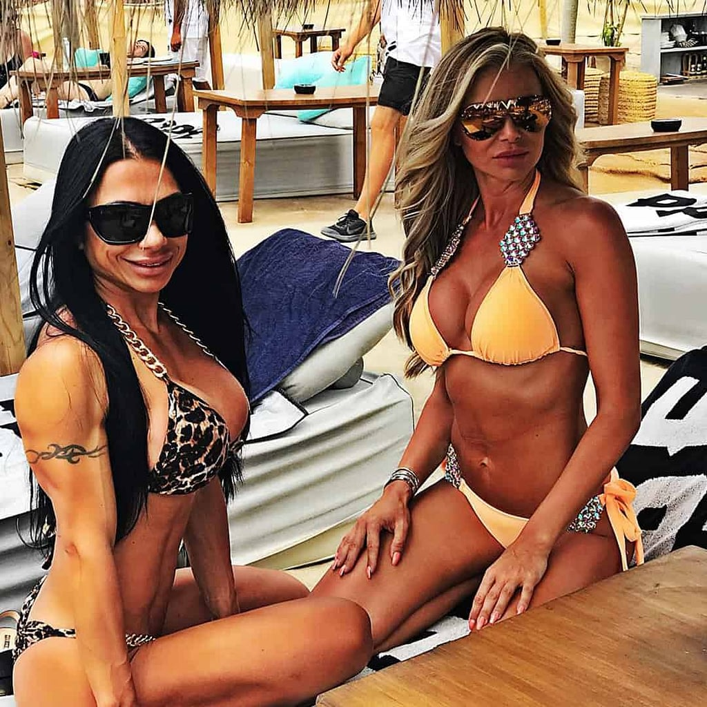 An image of Maria Bozinovska with her friend, in a beach bar. They are bth wearing bikinis and sunglasses on thir eyes.