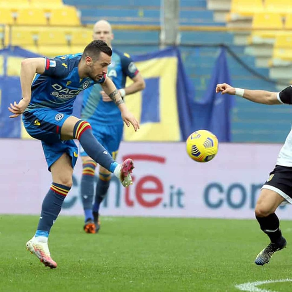 Ilija Nestorovski while playing footabll on a stadium. He is wearing blue jersey with yellow and red details.