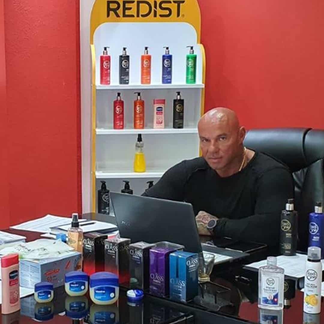 Tose Zafirov sitting at the Cosmos Group in front of a laptop computer. He is wearing black shirt and we can see many Redist products in front of him.