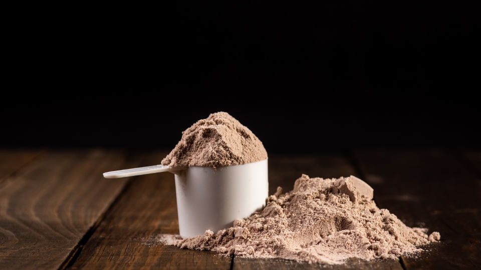 Chocolate protein powder in a dozer and scattered to it
