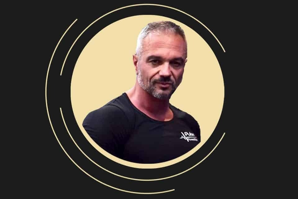 An image of Tome Danevski , a personal trainer in the Pulse Fitness and Spa, in a yellow circle, on a black backgorund.